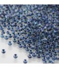 TOHO Round 11/0 Inside-Color Luster Crystal/Capri Blue Lined